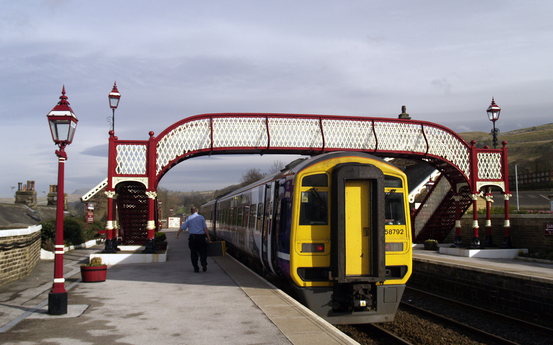 A northbound Northern Rail service pauses at Settle en route to Carlisle (photo © hidden europe).