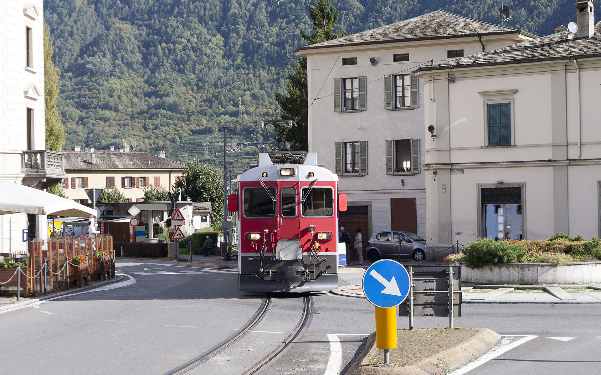 A Swiss train on the Bernina route arrives in Tirano. The railway actually threads through the streets of the Italian town (photo © Janis Smits / dreamstime.com)