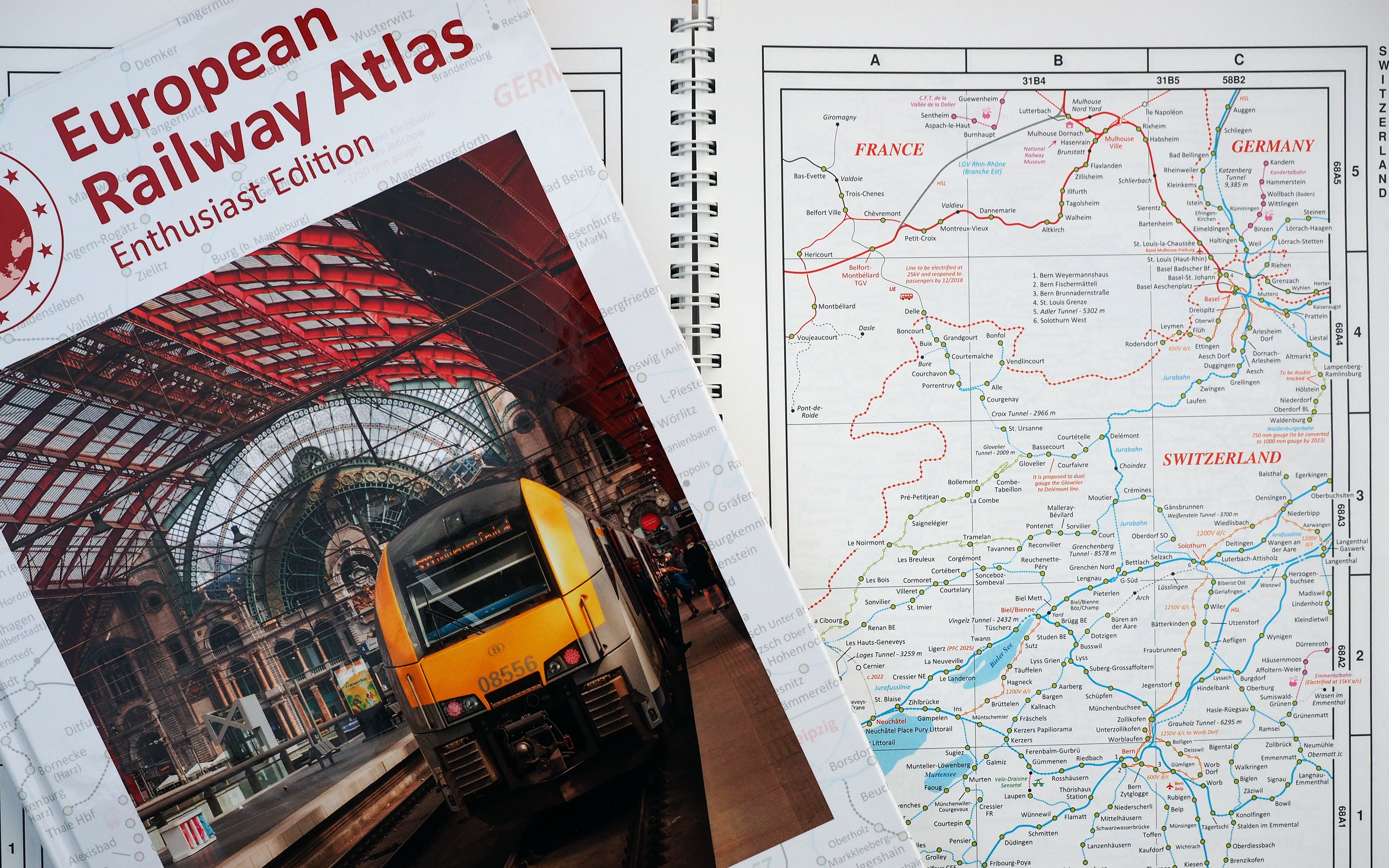 The front cover of the new Enthusiast Edition of the European Railway Atlas. In the background is a sample of the old 2017 edition which was cardback and wiro-bound. The new book is hardback.
